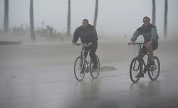 Two guys ride their bicycle along a flooded street on the waterfront of Fort Lauderdale, FL, USA, as Hurricane Irma passes through on Sunday, September 10, 2017. Photo by Paul Chiasson/CP/ABACAPRESS.COM