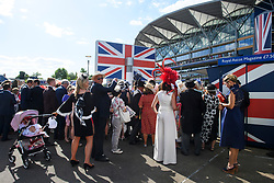 © Licensed to London News Pictures. 21/06/2018. London, UK. Racegoers take part in a singalong at the end of Ladies Day at Royal Ascot at Ascot racecourse in Berkshire, on June 21, 2018. The 5 day showcase event, which is one of the highlights of the racing calendar, has been held at the famous Berkshire course since 1711 and tradition is a hallmark of the meeting. Top hats and tails remain compulsory in parts of the course. Photo credit: Ben Cawthra/LNP