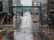 """18 MARCH 2020 - DES MOINES, IOWA: Downtown Des Moines was nearly deserted Wednesday morning as more Des Moines businesses went to a """"work at home"""" policy. On Wednesday morning, 18 March, Iowa reported 29 confirmed cases of the Coronavirus. Restaurants, bars, movie theaters, places that draw crowds are closed for at least 30 days. There are no """"shelter in place"""" orders in effect anywhere in Iowa but people are being encouraged to practice """"social distancing"""" and many businesses are requiring or encouraging employees to telecommute.      PHOTO BY JACK KURTZ"""