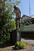 A golfer tees off from the top of a discarded television on World Urban Golf Day in Newcastle, Australia. Played with soft balls and without keeping score, Urban Golf is an attempt to take the game of golf away from the manicured lawns and into the urban environment.