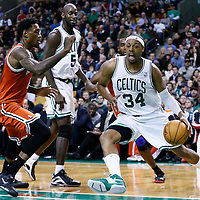21 December 2012: Boston Celtics small forward Paul Pierce (34) drives past Milwaukee Bucks center Larry Sanders (8) during the Milwaukee Bucks 99-94 overtime victory over the Boston Celtics at the TD Garden, Boston, Massachusetts, USA.