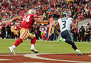 Nov 26, 2017; Santa Clara, CA, USA; Seattle Seahawks quarterback Russell Wilson (3) is flushed from the pocket by San Francisco 49ers defensive end Solomon Thomas (94) in the second quarter at Levi's Stadium.  Seattle beat San Francisco 24-13.