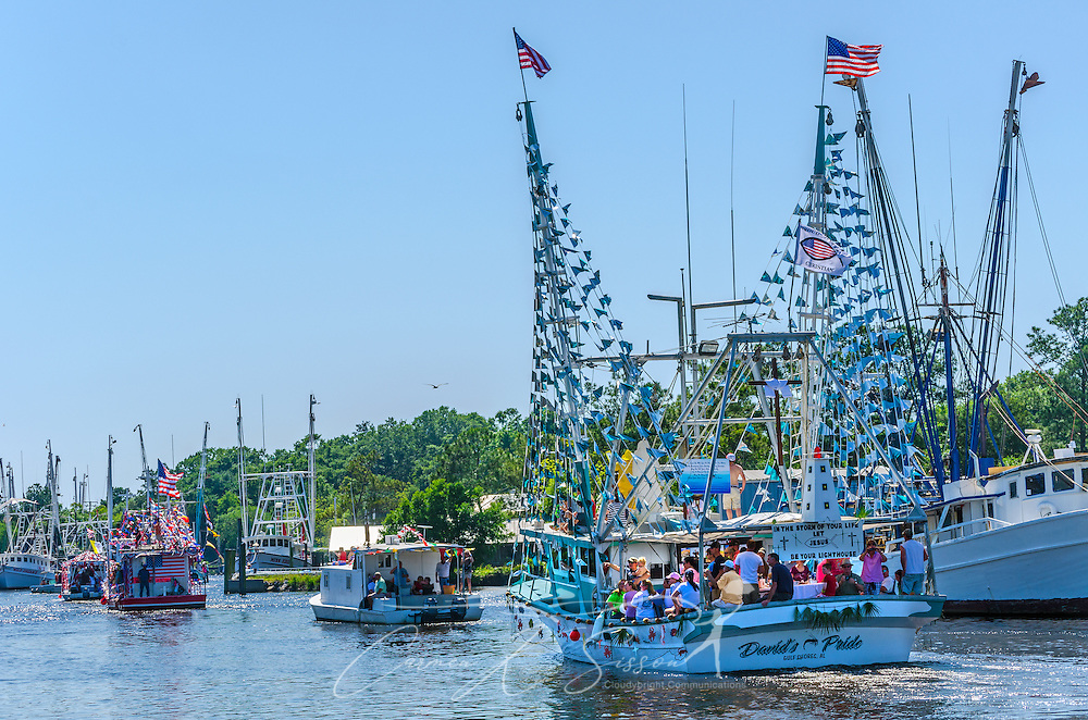 """David's Pride,"" based out of Gulf Shores, Alabama, participates in the 65th annual Blessing of the Fleet in Bayou La Batre, Alabama, May 4, 2014. The vessel took first place among the decorated, large commercial boats. The first fleet blessing was held by St. Margaret's Catholic Church in 1949, carrying on a long European tradition of asking God's favor for a bountiful seafood harvest and protection from the perils of the sea. The highlight of the event is a blessing of the boats by the local Catholic archbishop and the tossing of a ceremonial wreath in memory of those who have lost their lives at sea. The event also includes a land parade and a parade of decorated boats that slowly cruise through the bayou. (Photo by Carmen K. Sisson/Cloudybright)"