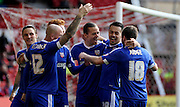 Brentford players celebrate withBrentford forward Lasse Vibe during the Sky Bet Championship match between Nottingham Forest and Brentford at the City Ground, Nottingham, England on 2 April 2016. Photo by Chris Wynne.