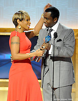 Mary J. Blige accepts her award from Sean Diddy Combs at the 2nd Annual BET Honors