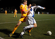 9 NOV. 2010 -- ST. LOUIS -- Christian Brothers College High School soccer player Alec Cochran (3, left) and St. Louis University High School's Brian Bement (14) battle for control of the ball near the box defended by CBC during the second half of the MSHSAA Class 3 Sectional game at SLUH Tuesday, Nov. 9, 2010. The Jr. Bills won, 2-1, on a pair of first half goals by Ryan Merrifield. SLUH will take on Jackson High School Saturday, Nov. 13 at Jackson. Image © copyright 2010 Sid Hastings.