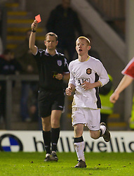 WARRINGTON, ENGLAND - Tuesday, February 26, 2008: Manchester United's Richard Eckersley is shown the red card and sent off by referee C D Sarginson during the FA Premiership Reserves League (Northern Division) match against Liverpool at the Halliwell Jones Stadium. (Photo by David Rawcliffe/Propaganda)