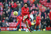 Liverpool forward Mohamed Salah (11) warming up during the Premier League match between Liverpool and Brighton and Hove Albion at Anfield, Liverpool, England on 30 November 2019.