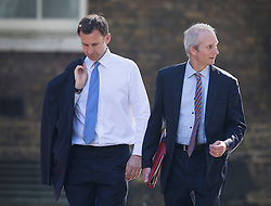© Licensed to London News Pictures. 19/07/2016. London, UK. Health Secretary Jeremy Hunt (L) and David Lidington MP<br /> Lord President of the Council, Leader of the House of Commons, arrive in Downing Street for Prime Minister Theresa May's first cabinet.  Photo credit: Peter Macdiarmid/LNP