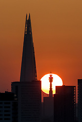 © Licensed to London News Pictures. 05/05/2018. London, UK. The sun sets behind the BT Tower, as seen from Greenwich Park. The warm weather over this bank holiday is forecast to peak on Monday, and is set to be the warmest on record. Photo credit : Tom Nicholson/LNP