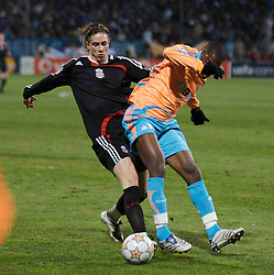 MARSEILLE, FRANCE - Tuesday, December 11, 2007: Liverpool's Fernando Torres and Olympique de Marseille's Jacques Faty during the final UEFA Champions League Group A match at the Stade Velodrome. (Photo by David Rawcliffe/Propaganda)