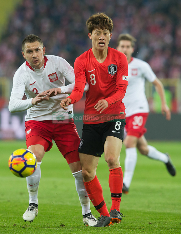 March 27, 2018 - Chorzow, Poland - Artur Jedrzejczyk of Poland vies Jae-sung Lee (KOR),   during the international friendly soccer match between Poland and South Korea national football teams, at the Silesian Stadium in Chorzow, Poland on 27 March 2018. (Credit Image: © Foto Olimpik/NurPhoto via ZUMA Press)