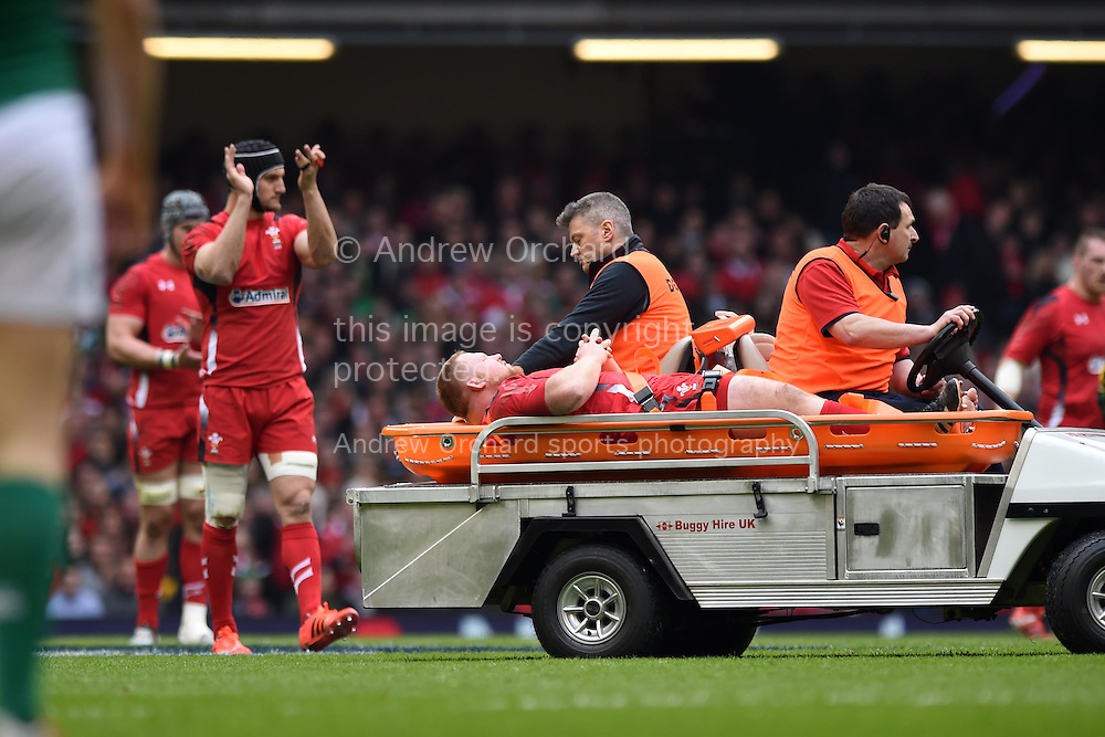 Samson Lee of Wales leaves the field injured as his capt Sam Warburton claps him off.  RBS Six nations 2015 championship, Wales v Ireland  at the Millennium stadium in Cardiff, South Wales on Saturday 14th March 2015<br /> pic by Andrew Orchard, Andrew Orchard sports photography.