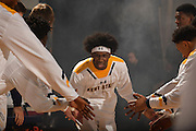 Kent State University men's basketball guard Jaylin Walker greets his teammates as he takes the floor for the team's first Mid-American Conference game of the 2016-2017 season. The Golden Flashes beat the Ball State Cardinals 100-90.
