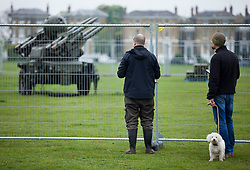 © Licensed to London News Pictures. 03/05/2012. LONDON, UK. Members of the public peer at a Rapier surface to air missile system (SAM) belonging to Sphinx Battery, 16 Regiment Royal Artillery, on Blackheath in London today (03/0512). The missiles have been deployed as part of an exercise involving the RAF, British Army and Royal Navy taking place across London as part of security preparations for the 2012 London Olympic Games. Photo credit: Matt Cetti-Roberts/LNP