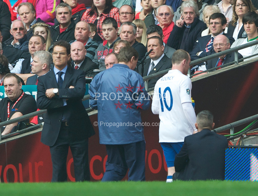 CARDIFF, WALES - Saturday, March 26, 2011: England's Wayne Rooney walks off down the tunnel after being substituted by head coach Fabio Capello during the UEFA Euro 2012 qualifying Group G match against Wales at the Millenium Stadium. (Photo by Dave Kendall/Propaganda)
