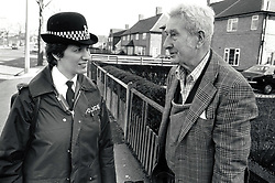 WPC chatting to elderly man, UK 1989