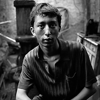 Hajim, 18-year-old apprentice is working at his father's forge at Katman Bazaar. Katman Bazaar is a small block located in the Old city of Kashgar in the Xinjiang province of China. The Uyghur blacksmiths have worked in these quarters for hundreds of years. Like most parts of the ancient Kashgar, Katman Bazaar is now under constant danger of being demolished for the sake of urban development supported by the Chinese government.