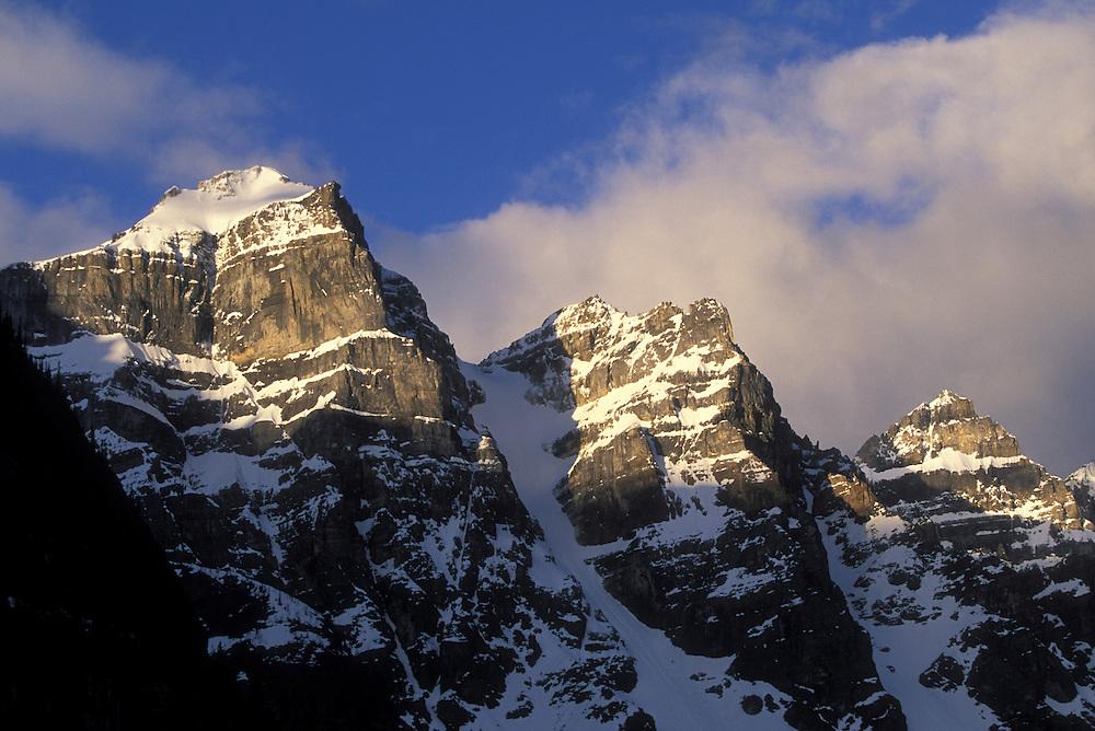 Canada, Alberta, Morning sun lights the Wenkchemna Peaks above Moraine Lake in Banff National Park