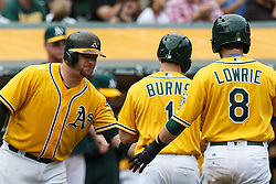 OAKLAND, CA - MAY 04: Billy Burns #1 of the Oakland Athletics and Jed Lowrie #8 after congratulated by Stephen Vogt #21 after both scored runs against the Seattle Mariners during the fifth inning at the Oakland Coliseum on May 4, 2016 in Oakland, California. (Photo by Jason O. Watson/Getty Images) *** Local Caption *** Billy Burns; Jed Lowrie; Stephen Vogt