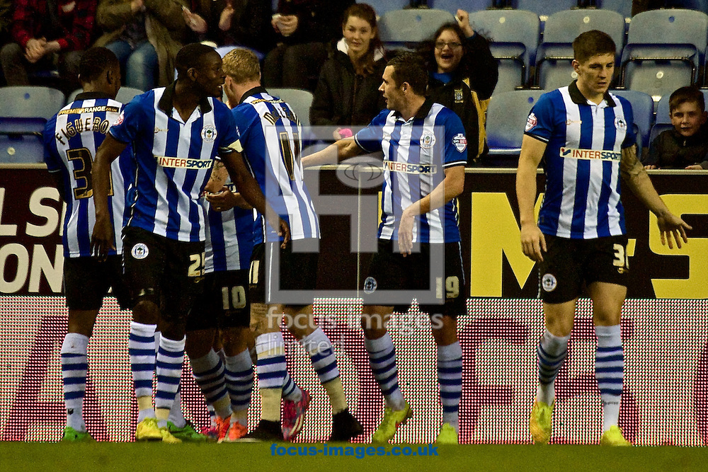 Wigan Athletic players celebrate after Shaun Maloney (number 10, (hidden)en) scores their third goal to make it Wigan Athletic 3 Fulham 2 during the Sky Bet Championship match at the DW Stadium, Wigan<br /> Picture by Ian Wadkins/Focus Images Ltd +44 7877 568959<br /> 01/11/2014