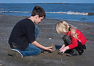 Gavin Terminie, 11, and his sister, Kaelyn Terminie, 4, play on the beach March 6, 2011 in Grand Isle, La. The island was heavily impacted by the Deepwater Horizon oil spill April 20, 2010 and continues to recover. The beach has been closed since the oil spill but re-opened in February. (Photo by Carmen K. Sisson)