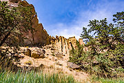 View of the Christian Brothers and Dihedrals section of the southern ridge, taken from the River Trail, just above The Crooked River in Smith Rock State Park, Oregon
