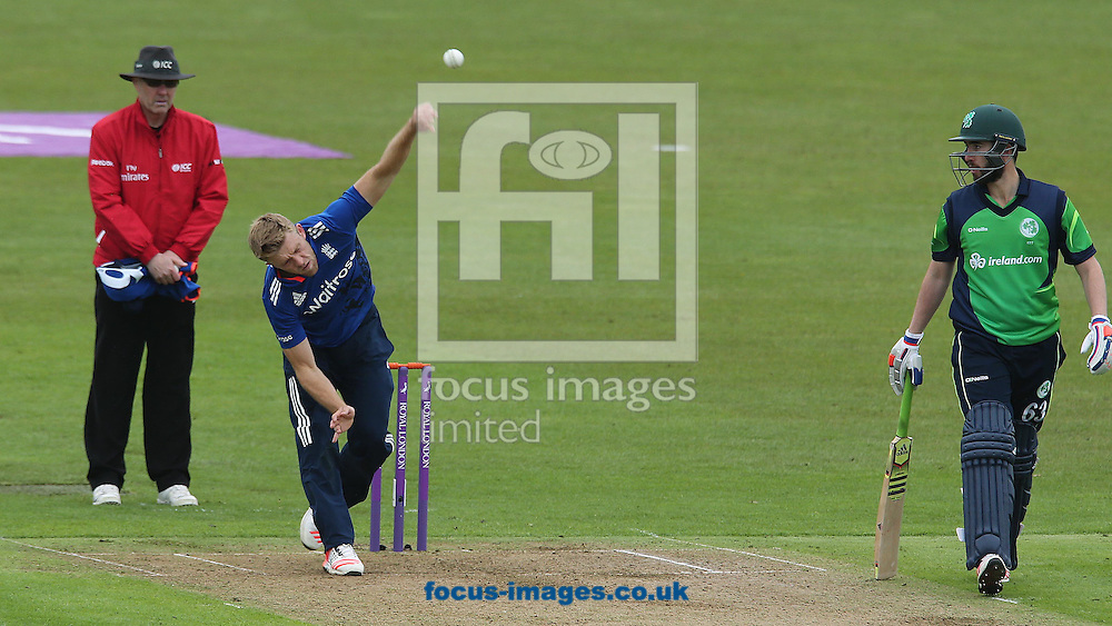 David Willey bowles for England watched by Andrew Balbirnie during the One Day International match at the Village, Malahide<br /> Picture by Lorraine O'Sullivan/Focus Images Ltd +353 872341584<br /> 08/05/2015