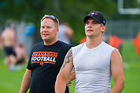 KELOWNA, CANADA - JULY 17:  Coach Johannes Van Leenan stands on the field with quarterback Jakob Loucks as the Okanagan Sun football season gets underway with Day of training camp on July 17, 2018 at the Apple Bowl in Kelowna, British Columbia, Canada.  (Photo by Marissa Baecker/Shoot the Breeze)  *** Local Caption ***