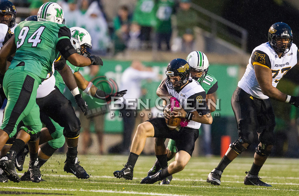 Oct 9, 2015; Huntington, WV, USA; Marshall Thundering Herd defensive back Corey Tindal sacks Southern Miss Golden Eagles quarterback Nick Mullens during the first quarter at Joan C. Edwards Stadium. Mandatory Credit: Ben Queen-USA TODAY Sports
