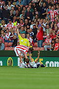 Stoke City midfielder Charlie Adam is sent off following his tackle on West Bromwich Albion defender Craig Dawson during the Barclays Premier League match between Stoke City and West Bromwich Albion at the Britannia Stadium, Stoke-on-Trent, England on 29 August 2015. Photo by Aaron Lupton.