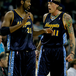Dec 18, 2009; New Orleans, LA, USA;  Denver Nuggets center Chris Andersen (11) talks with center Nene Hilario (31) during the first half against the New Orleans Hornets at the New Orleans Arena. Mandatory Credit: Derick E. Hingle-US PRESSWIRE