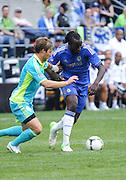 July 18, 2012: CenturyLink Field, Seattle, WA: Chelsea FC Romelu Lukaku breaks past Sounders Jeff Parke during the World Football Challenge. Chelsea FC defeated the Seattle Sounders 4-2.
