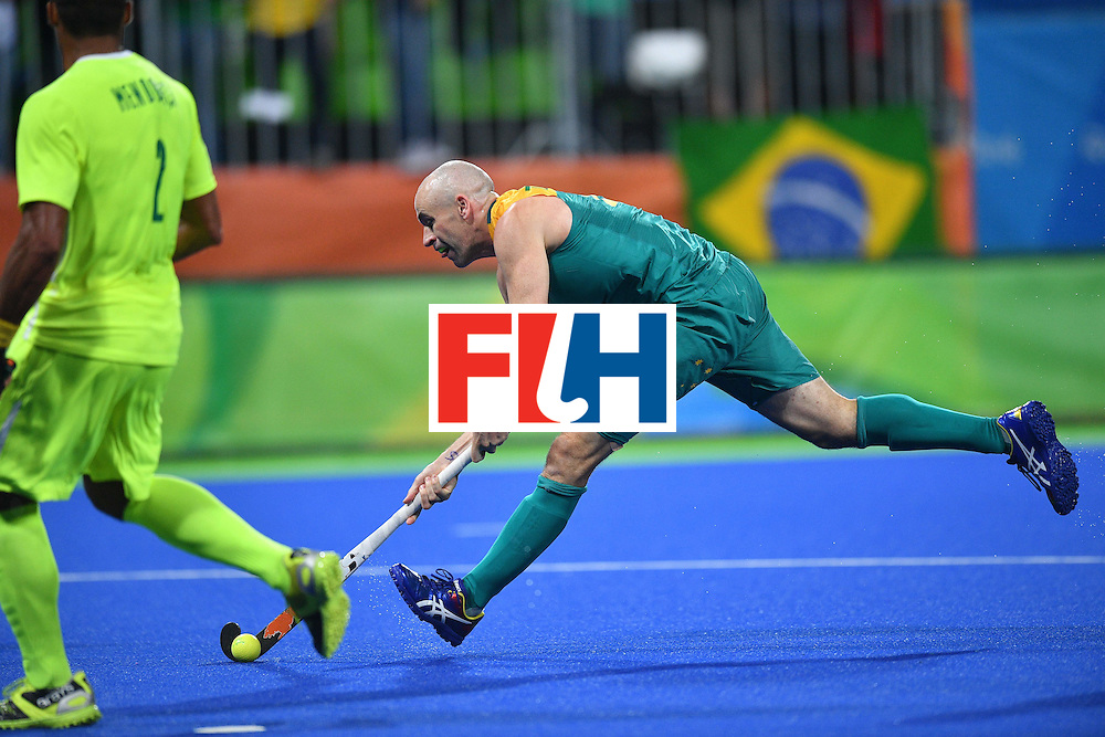 Australia's Glenn Turner plays the ball during the mens's field hockey Australia vs Brazil match of the Rio 2016 Olympics Games at the Olympic Hockey Centre in Rio de Janeiro on August, 12 2016. / AFP / Carl DE SOUZA        (Photo credit should read CARL DE SOUZA/AFP/Getty Images)