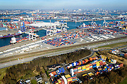 Nederland, Zuid-Holland, Rotterdam, 18-02-2015. Pernis,  Vondelingenweg, containers van ECT op terrein Prins Willem Alexanderhaven. Sporen van de Betuweroute. Distripark Eemhaven, Rotterdam Albrandswaard.<br /> Containers of ECT terminal, Betuweroute freight train tracks.<br /> luchtfoto (toeslag op standard tarieven);<br /> aerial photo (additional fee required);<br /> copyright foto/photo Siebe Swart