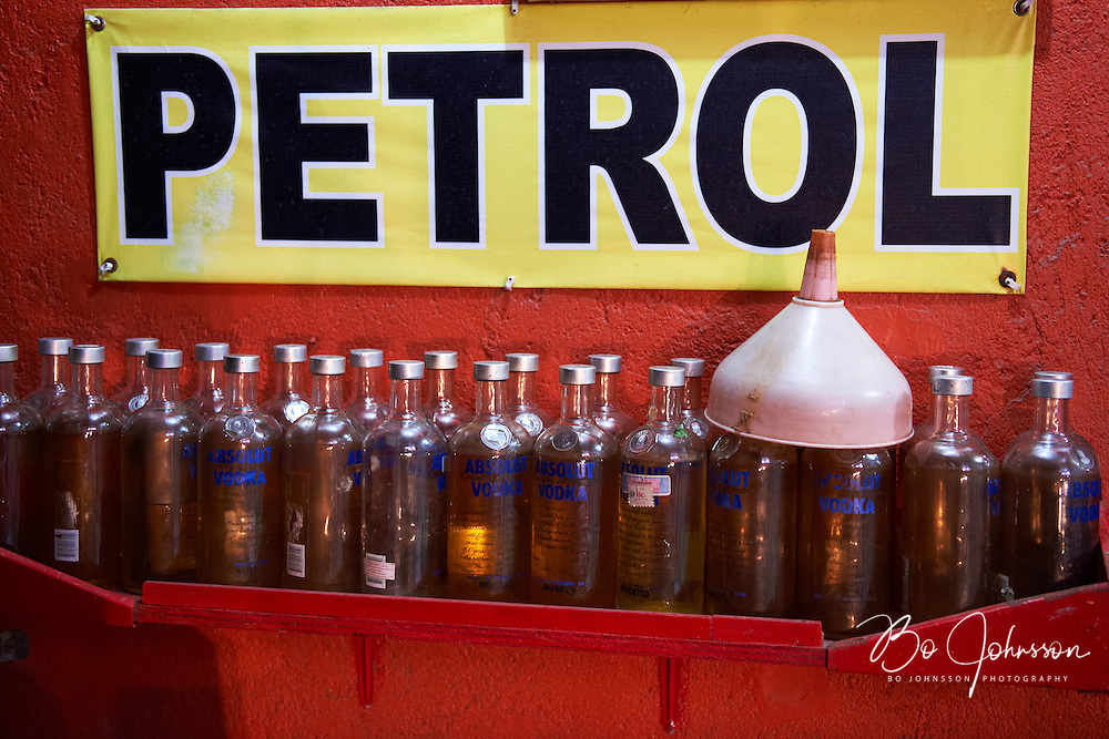 Petrol filling station in the alley.<br /> Jl Benesari, Kuta, Bali, Indonesia.<br /> August 2011.