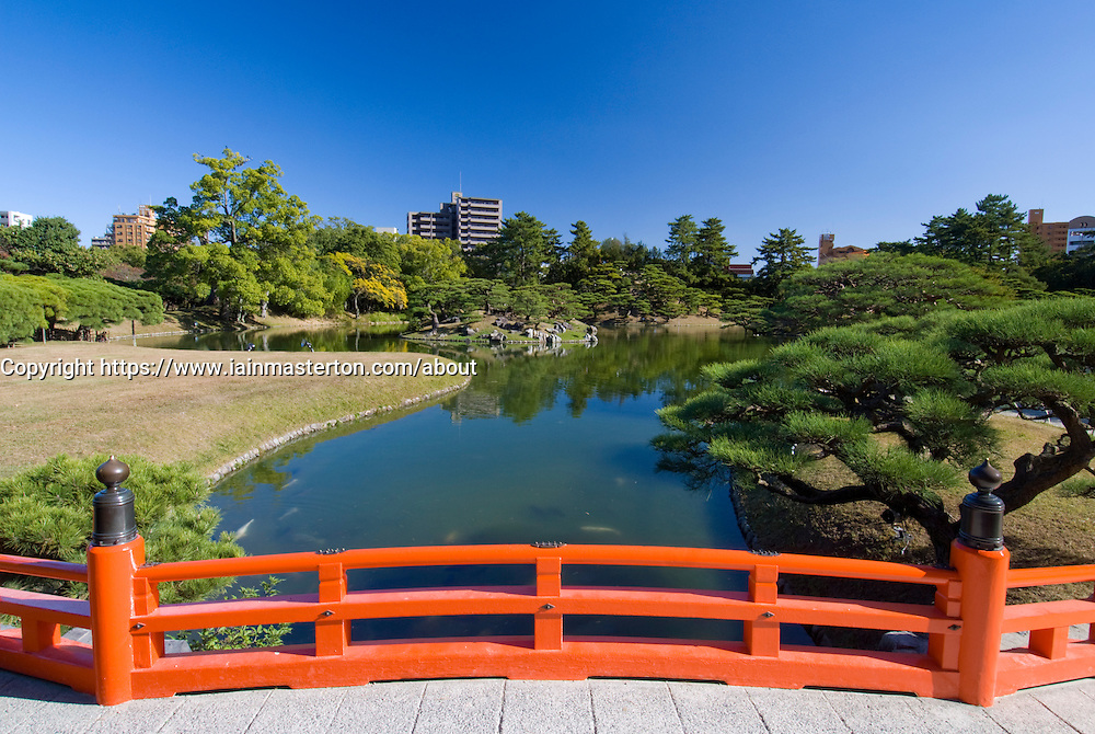 Red wooden footbridge in famous Ritsuin Garden in Takamatsu Shikoku Japan