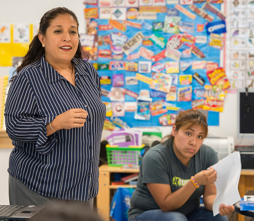 Maria Lopez works with the parents of her Pre-K students during an Academic Parent Teacher Team (APTT) at Whittier Elementary School, May 15, 2014.