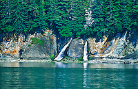 A glacier fed stream on the Sbetisham Peninsula flows into Stephens Passage.  Southeast Alaska.
