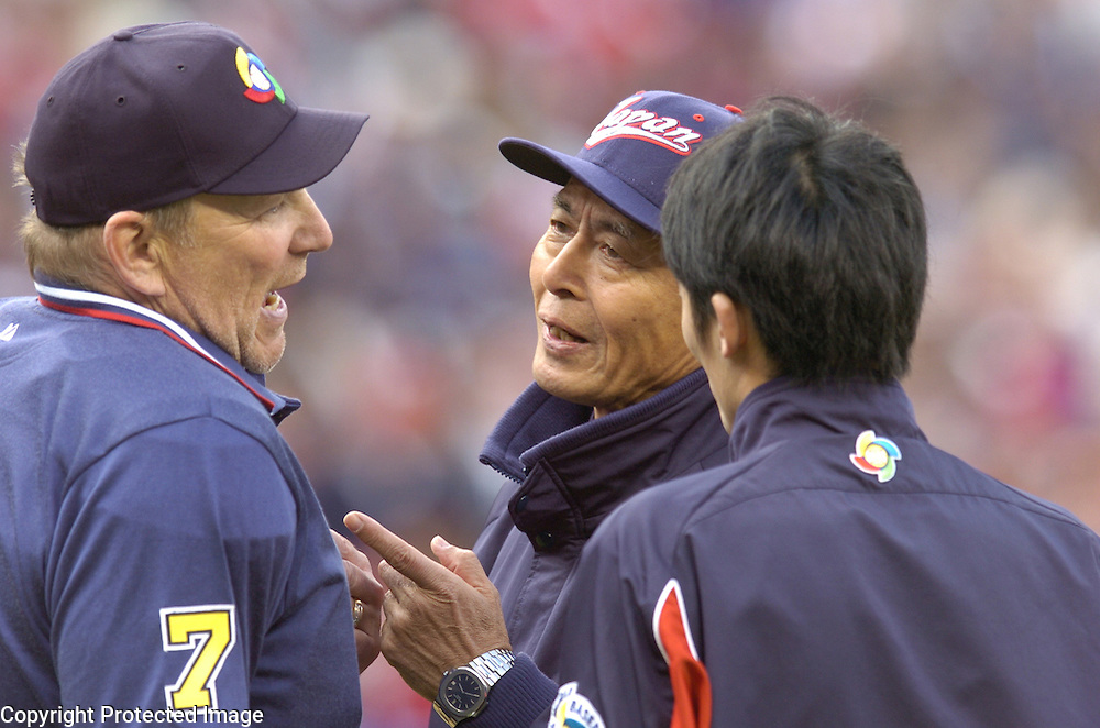 Team Japan manager Sadaharu Oh argues a disputed call in the 8th inning with home plate umpire Bob Davdidson in a game against Team USA in Round 2 action at Angel Stadium of Anaheim.