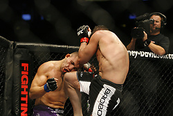 Apr 18, 2009; Montreal, Quebec, CAN; Steve Cantwell (black w/white) and Luiz Cane (black w/purple) battle during their light heavyweight bout at UFC 97: Redemption at the Bell Centre in Montreal, Canada.