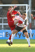Photo: Dave Linney.<br />Hereford United v Walsall. Coca Cola League 2. 18/11/2006. Hereford'  John Eustace(R) gets a boot in the face from Mark Kinsella.