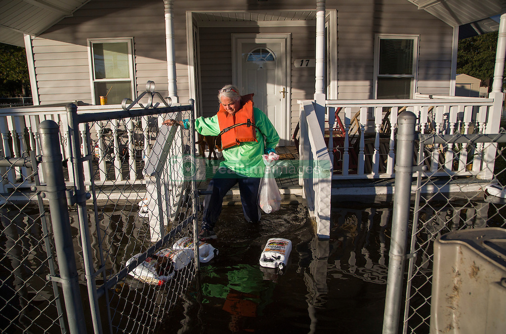 Delores Miller checks on her elderly mother's home in downtown Lumberton, NC, USA,, after Hurricane Matthew caused downed trees, power outages and massive flooding along the Lumber River, on Tuesday, October 11, 2016. Photo by Travis Long/Raleigh News & Observer/TNS/ABACAPRESS.COM