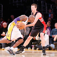 08 December 2013: Los Angeles Lakers shooting guard Kobe Bryant (24) drives past Toronto Raptors small forward Steve Novak (16) during the first half to the game between the Los Angeles Lakers and the Toronto Raptors at the Staples Center, Los Angeles, California, USA.