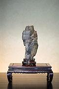 A suiseki stone is on display next to a bonsai tree at the Saitama Omiya Bonsai Museum of Art in Saitama, Japan on 15 Aug. 2011..Photographer: Robert Gilhooly