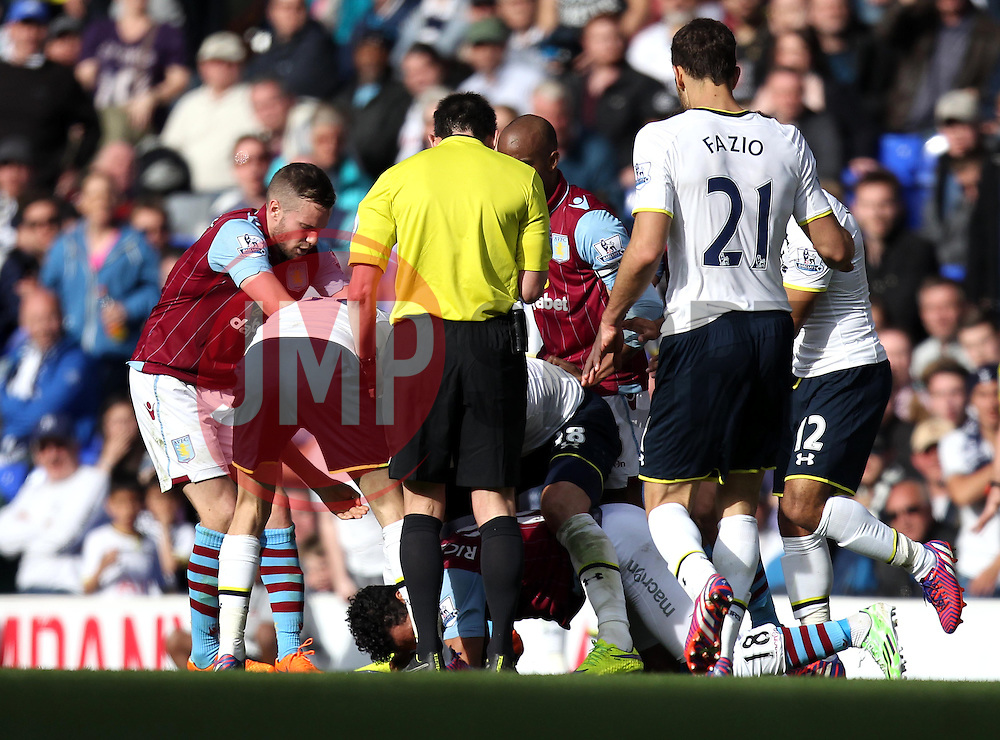 A fracas insures between the Tottenham and Aston Villa players - Photo mandatory by-line: Robbie Stephenson/JMP - Mobile: 07966 386802 - 11/04/2015 - SPORT - Football - London - White Hart Lane - Tottenham Hotspur v Aston Villa - Barclays Premier League