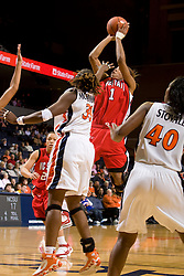 N.C. State forward Khadijah Whittington (1) shoots over Virginia center Aisha Mohammed (33).  The Virginia Cavaliers defeated the NC State Wolfpack women's basketball team 74-49 at the John Paul Jones Arena in Charlottesville, VA on February 1, 2008.