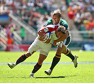 Twickenham, London - Sunday 23rd May 2010: Ben Gollings of England is tackled by Frankie Horne of South Africa during quarter final match of the Emirates London Sevens rugby tournament at Twickenham Stadium, London, UK. (Pic by Andrew Tobin/Focus Images)