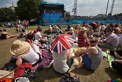 © licensed to London News Pictures. London, UK 10/08/2012. People enjoying hot weather and watching the Games in Potters Fields Park on 10/08/12. Photo credit: Tolga Akmen/LNP