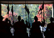 Royal Canadian Mounted Police are silhouetted against Autumn color at the Topsfield Fair.